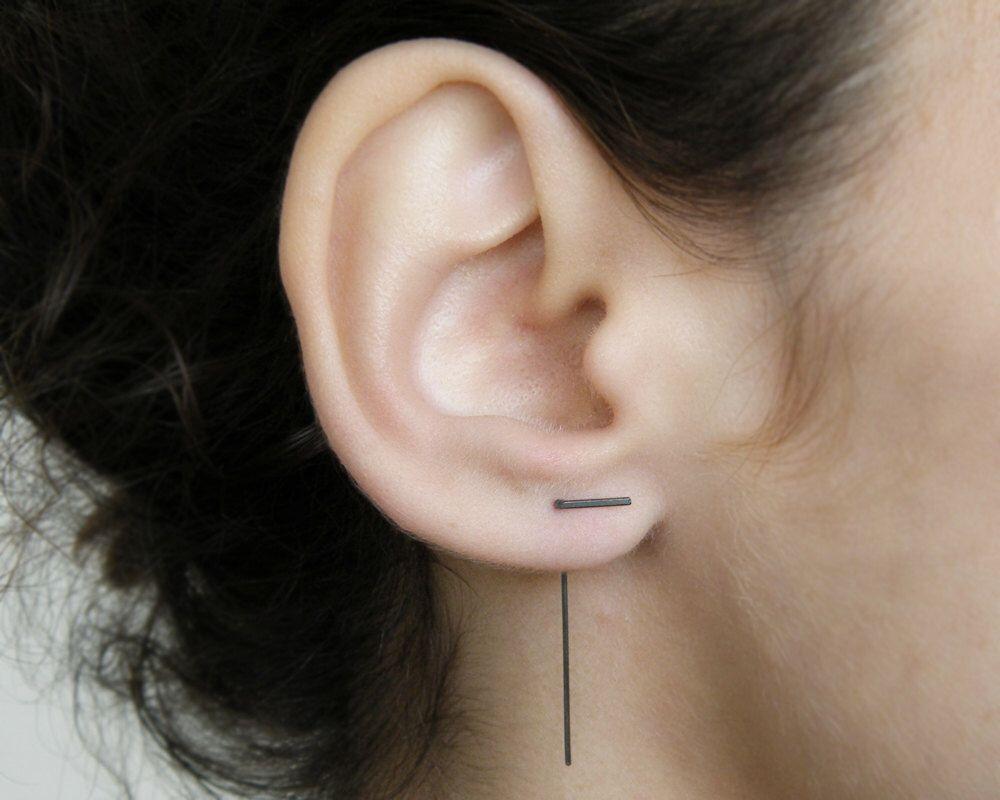 Ear piercing ideas simple  Silver line earrings Simple ear jackets Silver bar earrings