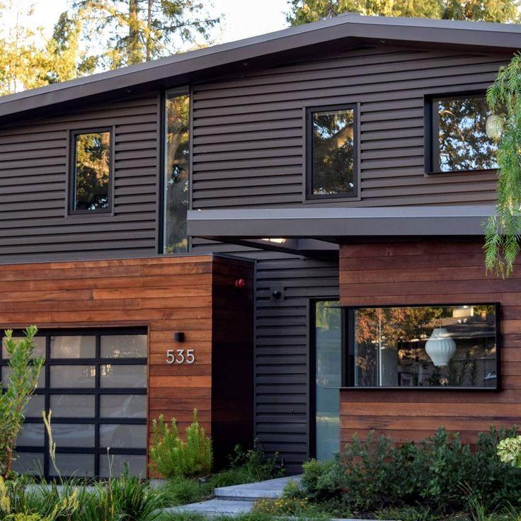 Modern Glass Garage Door Adds Sleek Texture To Home With