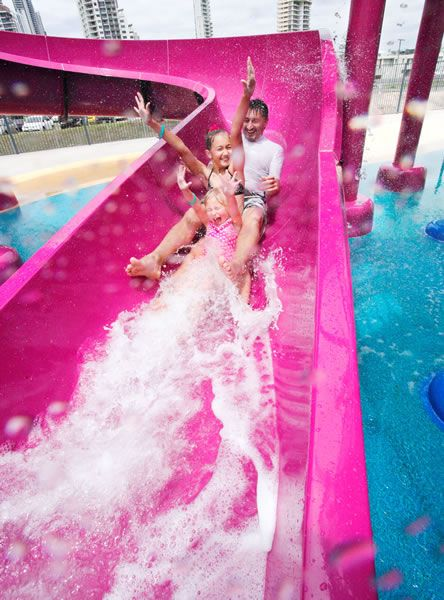 a giant pink water slide from your house to mine all pink