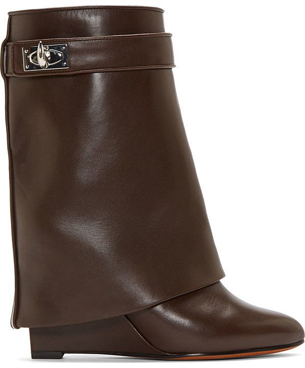 """Brown Leather Shark Lock Wedge Boots by Givenchy. Suede boots in black with layered trompe l'oeil body and covered heel. Pointed toe. Tonal wrap-around strap at collar with silver-tone shark tooth-shaped turn-lock clasp. Tone on tone stitching. Approx 4"""" wedge heel. Calfskin. Made in Italy. http://zocko.it/LEL5r"""