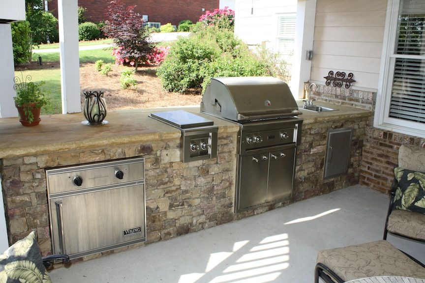 Stacked Stone Outdoor Kitchen Beneath Deck With Sink Burner And Warming Drawer Outdoor Kitchen Outdoor Outdoor Decor