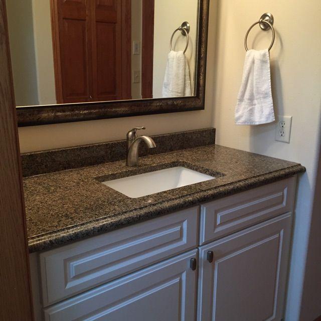 Thermofoil White Cabinet With A Labrador Granite Countertop