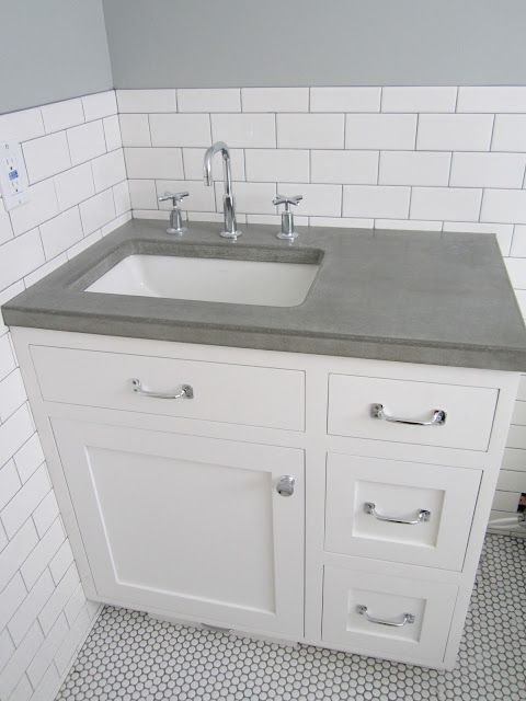 Concrete counter love the faucet subway tile like the Concrete countertops bathroom vanity