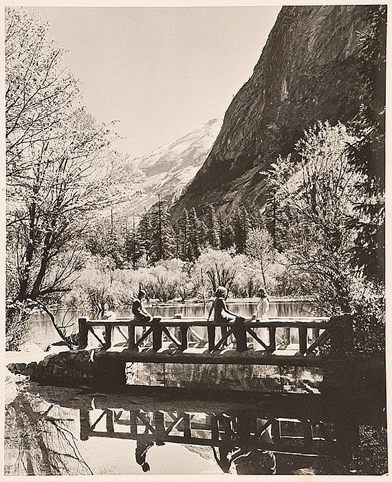 (PHOTOGRAPHS) ANSEL ADAMS. 'Muir Lake in Yosemite National Park'. Circa 1950. Depicting three figures on a bridge. 10' x 8'.