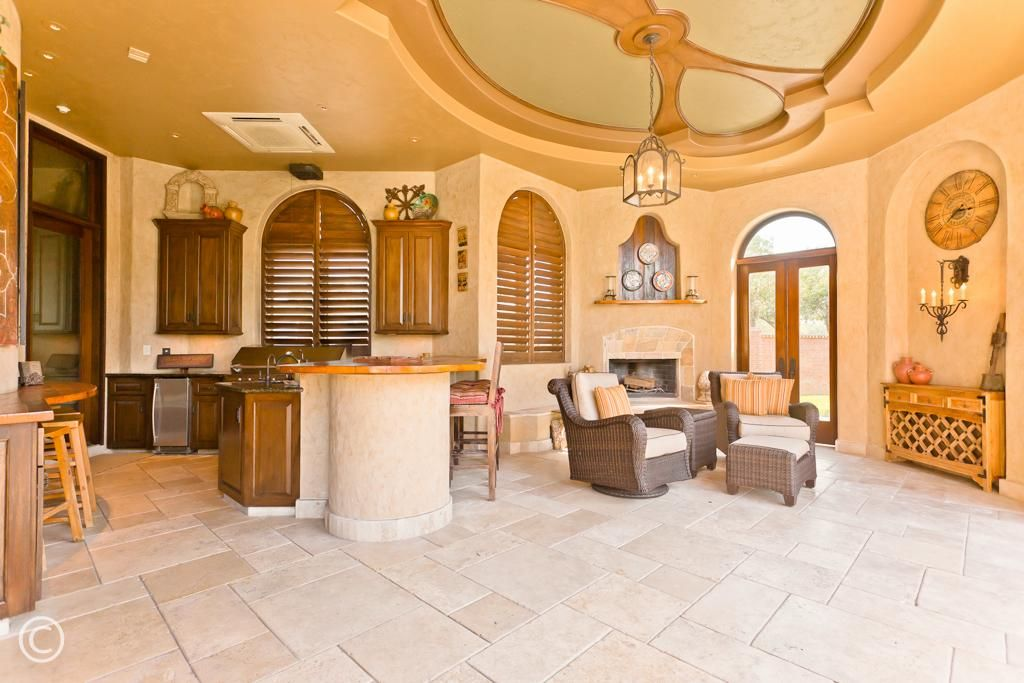 Fantastic loggia w/great fully equipped summer kitchen & wood burning fireplace - perfect outdoor living space for entertaining.  There is no need to go to the mountains or the beach; it's all available right here at home w/air conditioning to boot!
