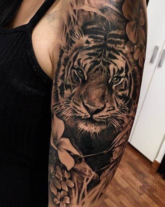 765425cb4 Black and grey tiger tattoo on the left upper arm and shoulder ...