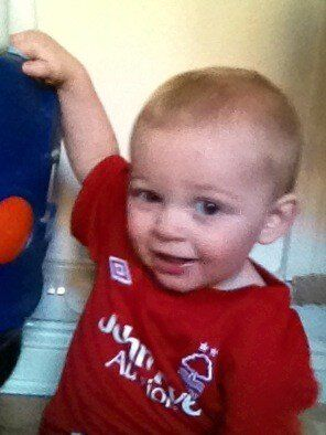 The little man loves his new forest shirt .!
