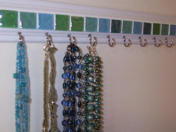This is a great idea!  I always need more space for hanging necklaces!