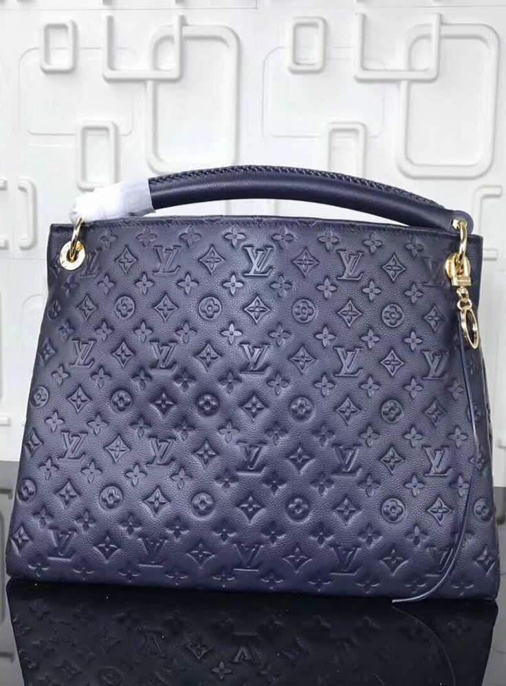 This Louis Vuitton Monogram Empreinte Leather Artsy MM