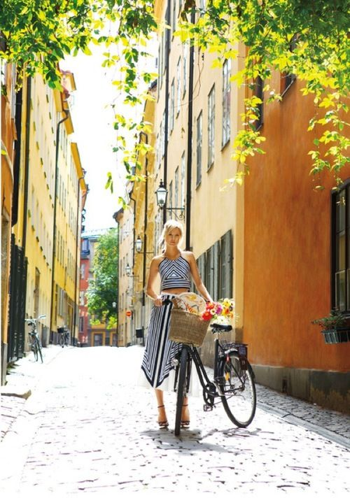 Woman wheeling her bicycle with basket - Check out Bicycles of Italy story by Patty Mooney at http://sandiegovideoproduction.com/bicycles-of-italy/