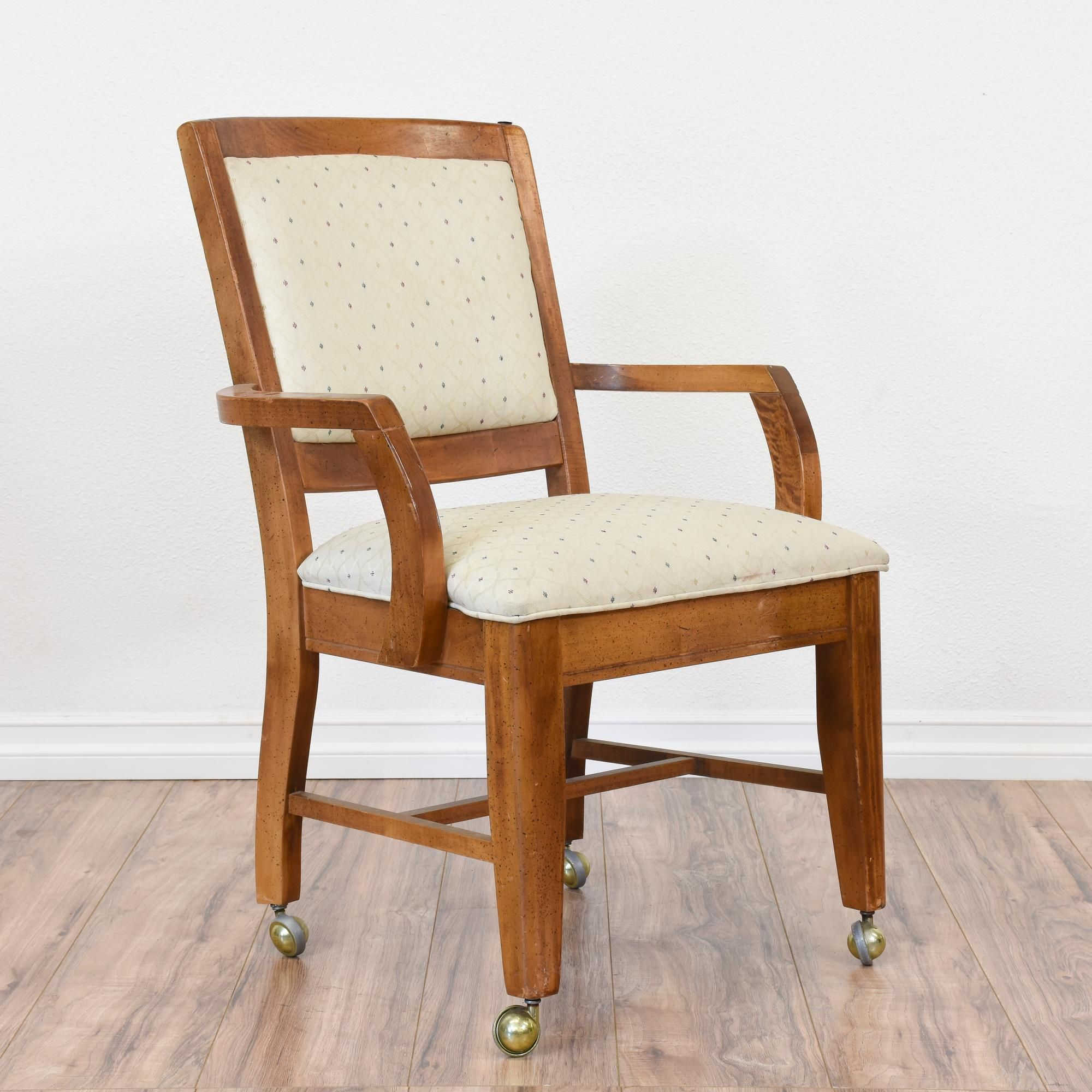 This rolling chair is featured in a solid wood with a glossy dark ...
