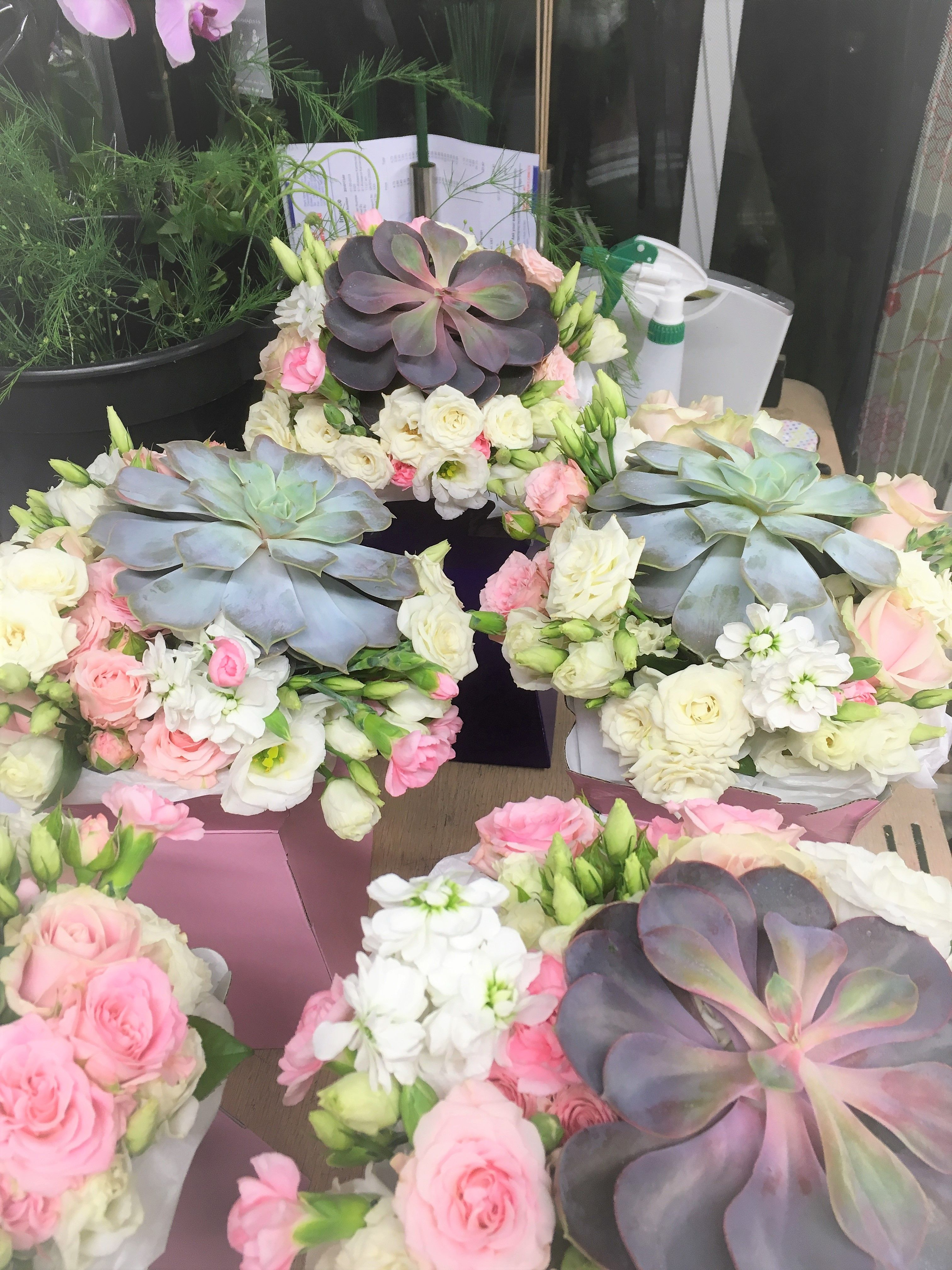 succulents and roses bridesmaids bouquets designed and