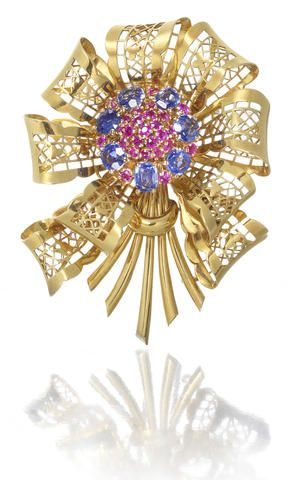 A sapphire and ruby brooch, by Van Cleef & Arpels,