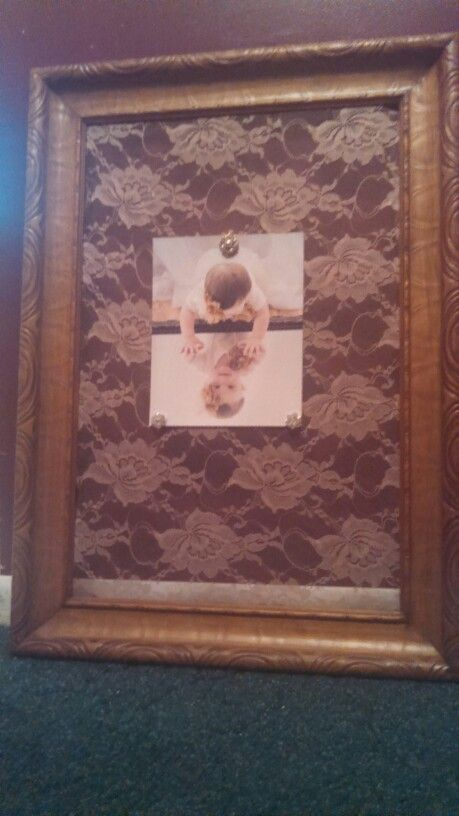 Up cycled frame with lace as a new changeable photo display board