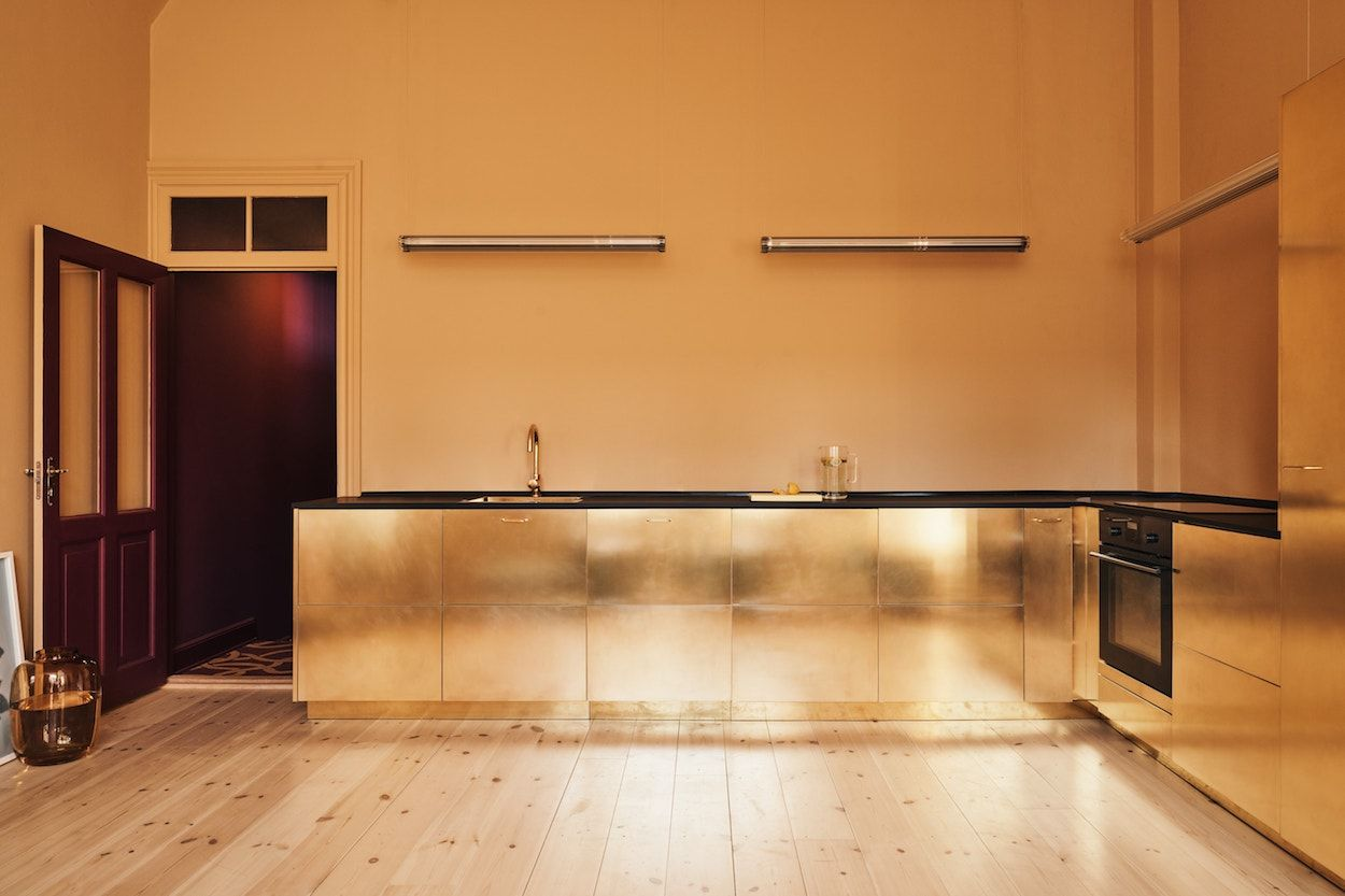 The Golden Brass Stine Goya Kitchen By Reform Brass Kitchen Gold Kitchen Studio Kitchen