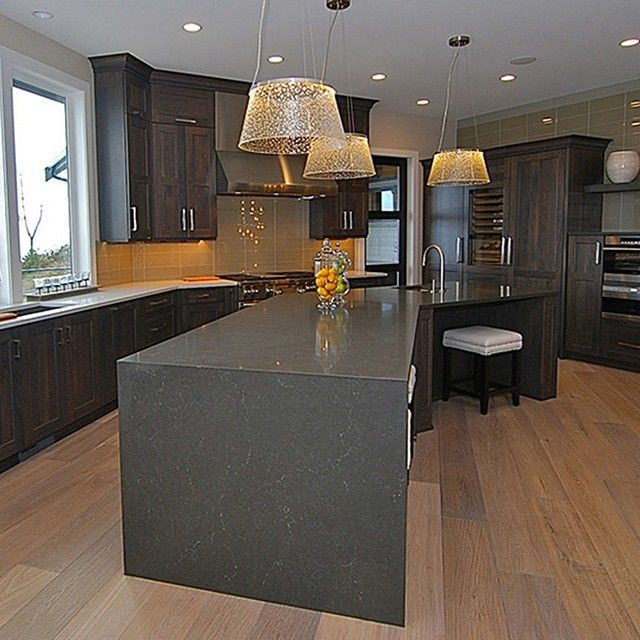 Remodel Your Kitchen For Maximum Storage And Light: We Love This Massive Angular Island In Piatra Grey! This