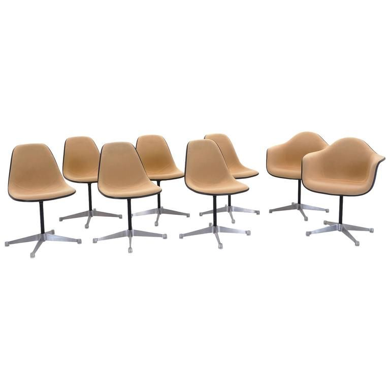 Set Of Eight Upholstered Eames Swivel Dining Chairs Two Arm And Six Side 1stdibs