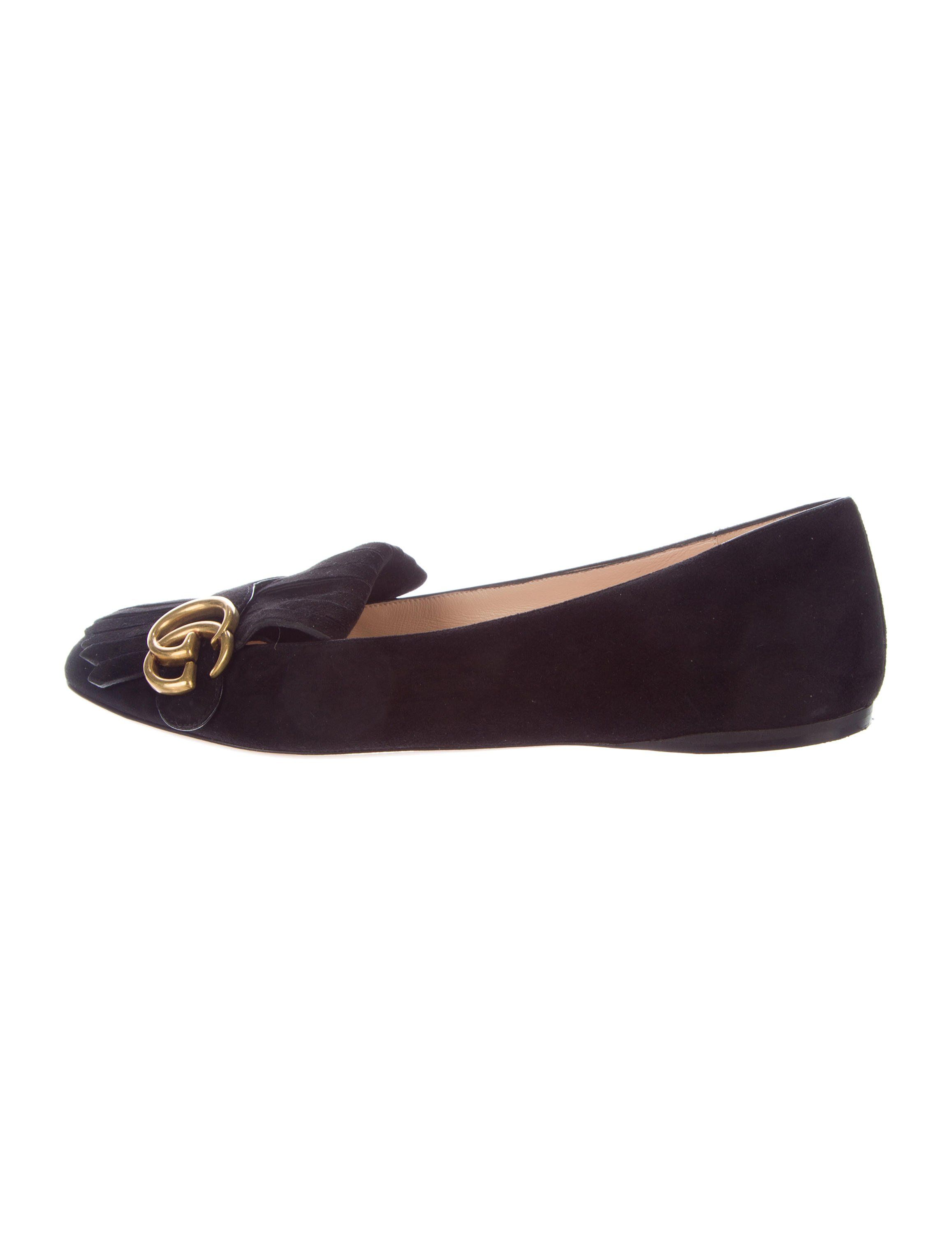 3e0a3af7478 Black suede Gucci Marmont flats with kiltie accents featuring gold-tone Marmont  GG at vamps and stacked heels. Includes dust bag.