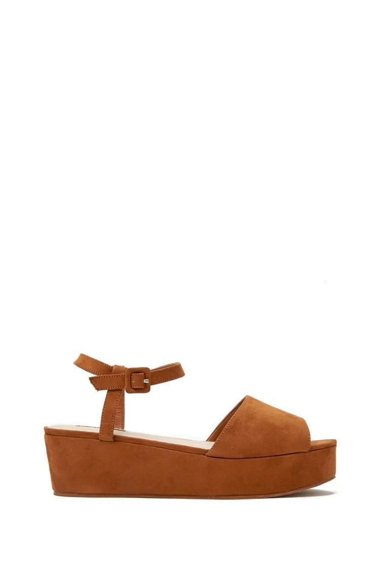 d0795fb7689 A pair of faux suede low platform wedge sandals featuring a buckled ankle  strap.