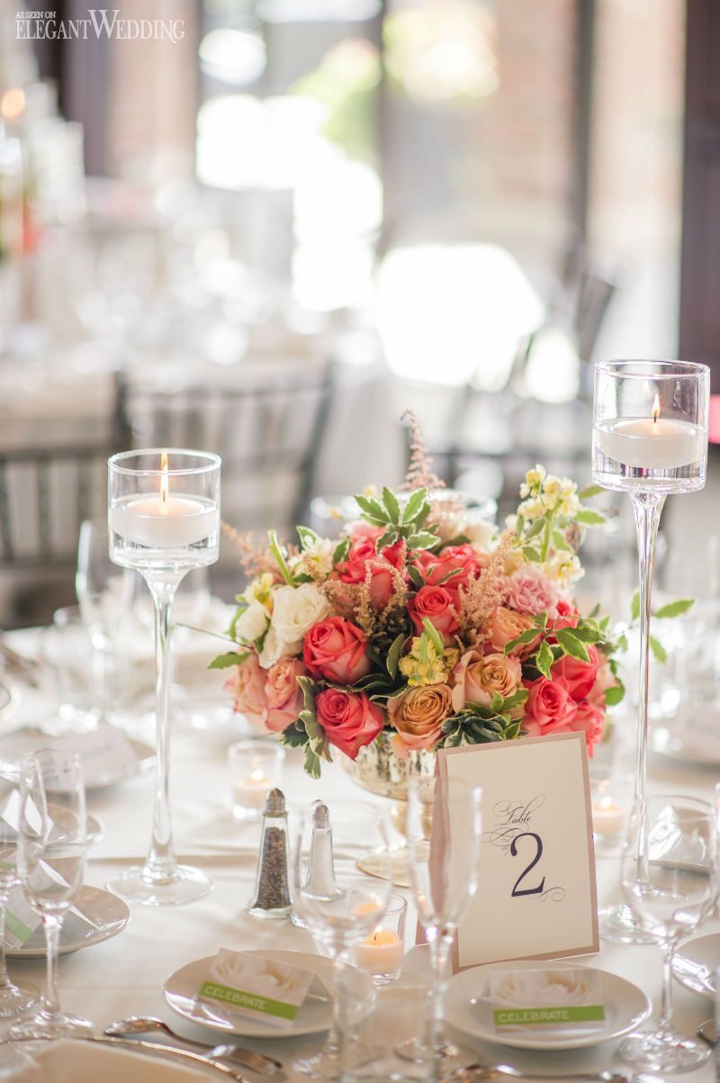 Orange and pink centrepieces! Bright popping flowers for a wedding ...