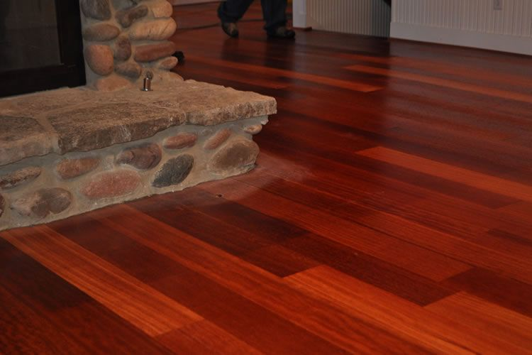 cherry wood floors and stone fireplace