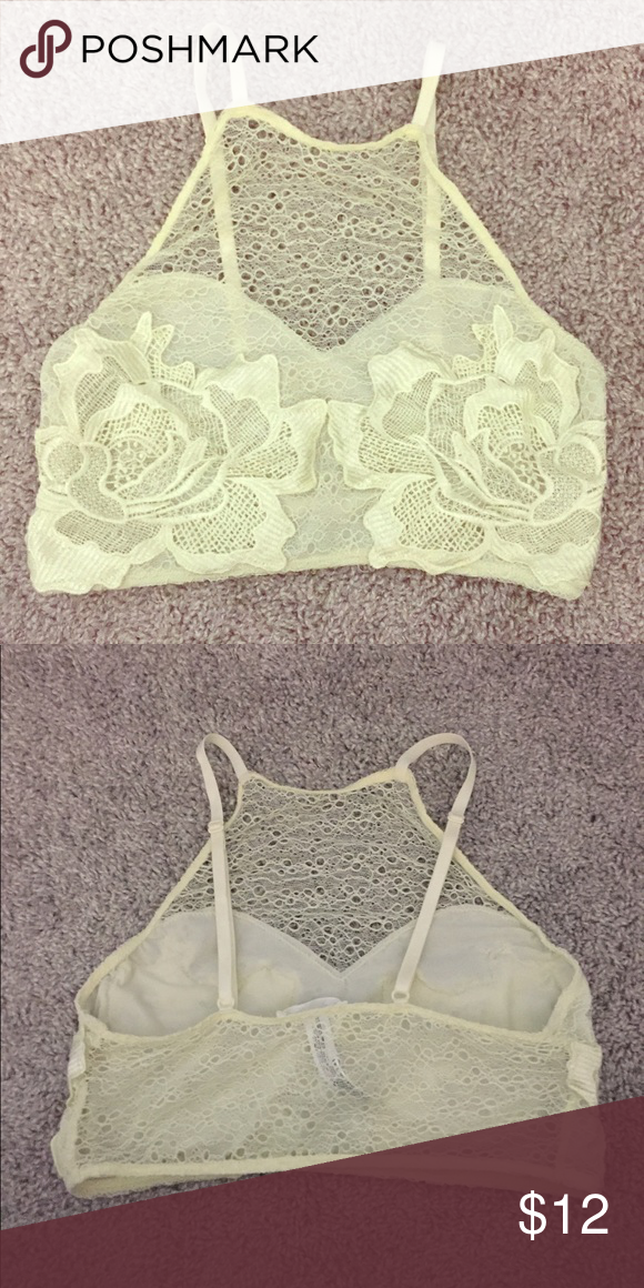 Lace bralette Urban Outfitters light yellow lace bralette with adjustable straps. Size Large, but runs smaller, so fits more like a Medium. Worn only once Urban Outfitters Intimates & Sleepwear Bras