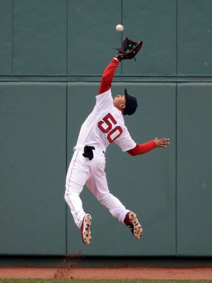 Boston Red Sox center fielder Mookie Betts catches a deep fly ball ...