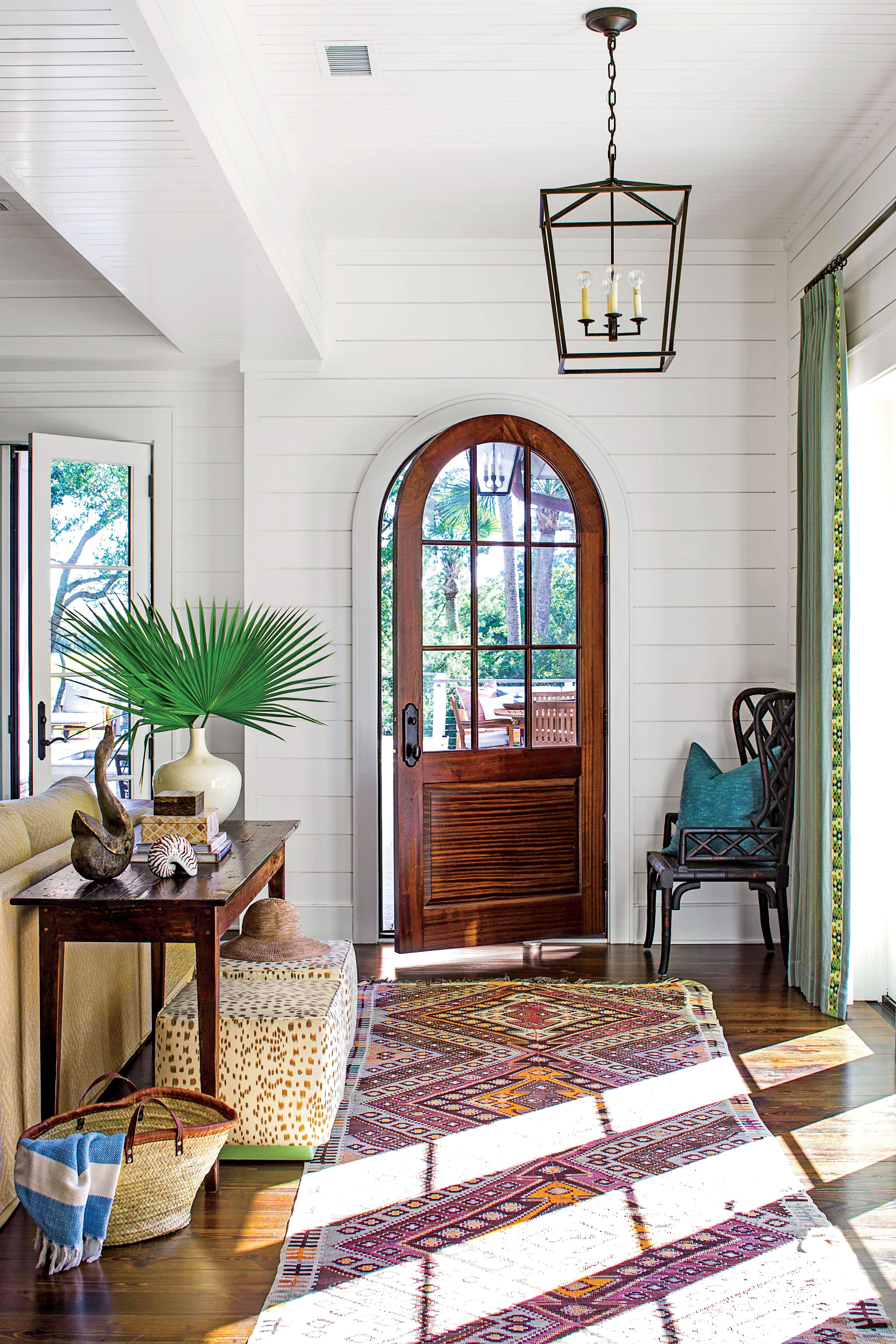 homeowners tall design trgn livi dallas wall are decor living designer ideas decorating of to many room for michaels on unsure decorate blog their foyer pl interior how story