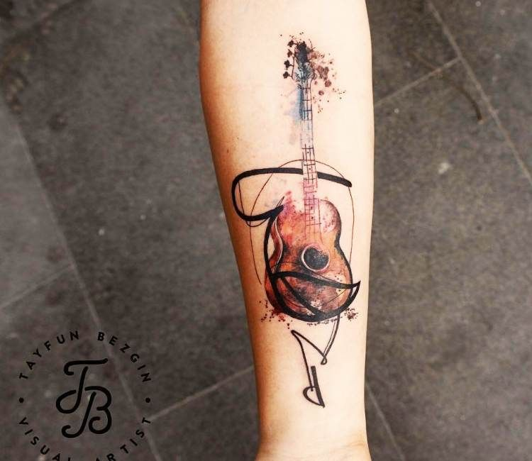 Guitar tattoo by Tattoo Tayfun