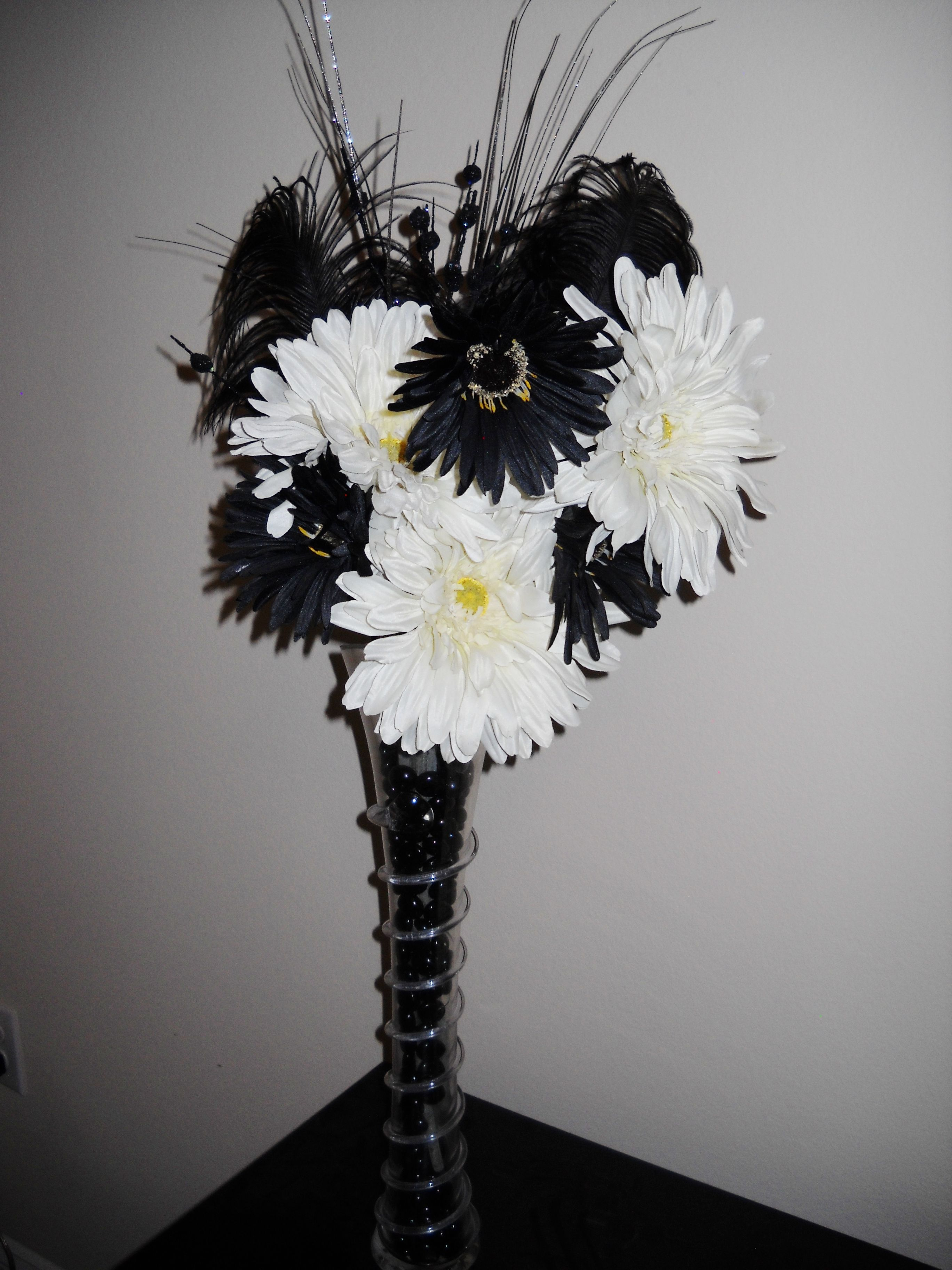 black & white flower arrangement with feathers White