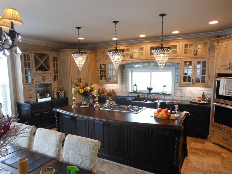 Walnut kitchen island made by Brooks Custom for Heller Cabinetry in
