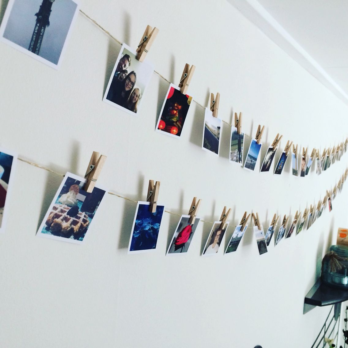 DIY pictures on a washing line with small washing pins.