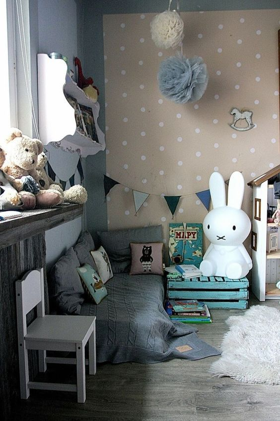 Lovely kids room including a big miffy bunny light, huge pom pom decorations, a polka dot feature wall and cute soft furnishings.