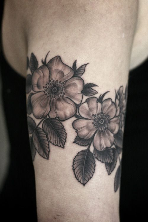 Wild Rose Black And White One Flower With A Geometric Background Sternum Piece Wild Rose Tattoo Rose Shoulder Tattoo Wrist Tattoo Cover Up