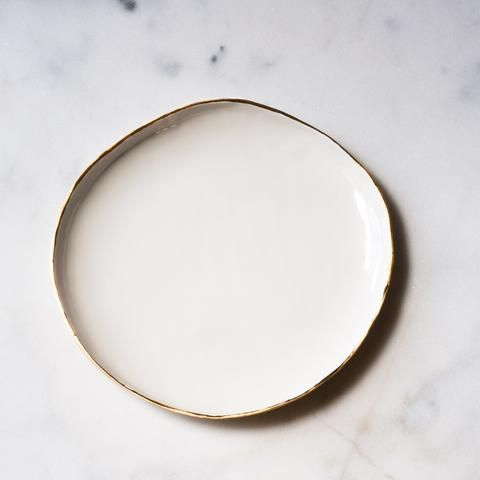 Simple, modern, and organic each dinner plate is hand shaped into a ...