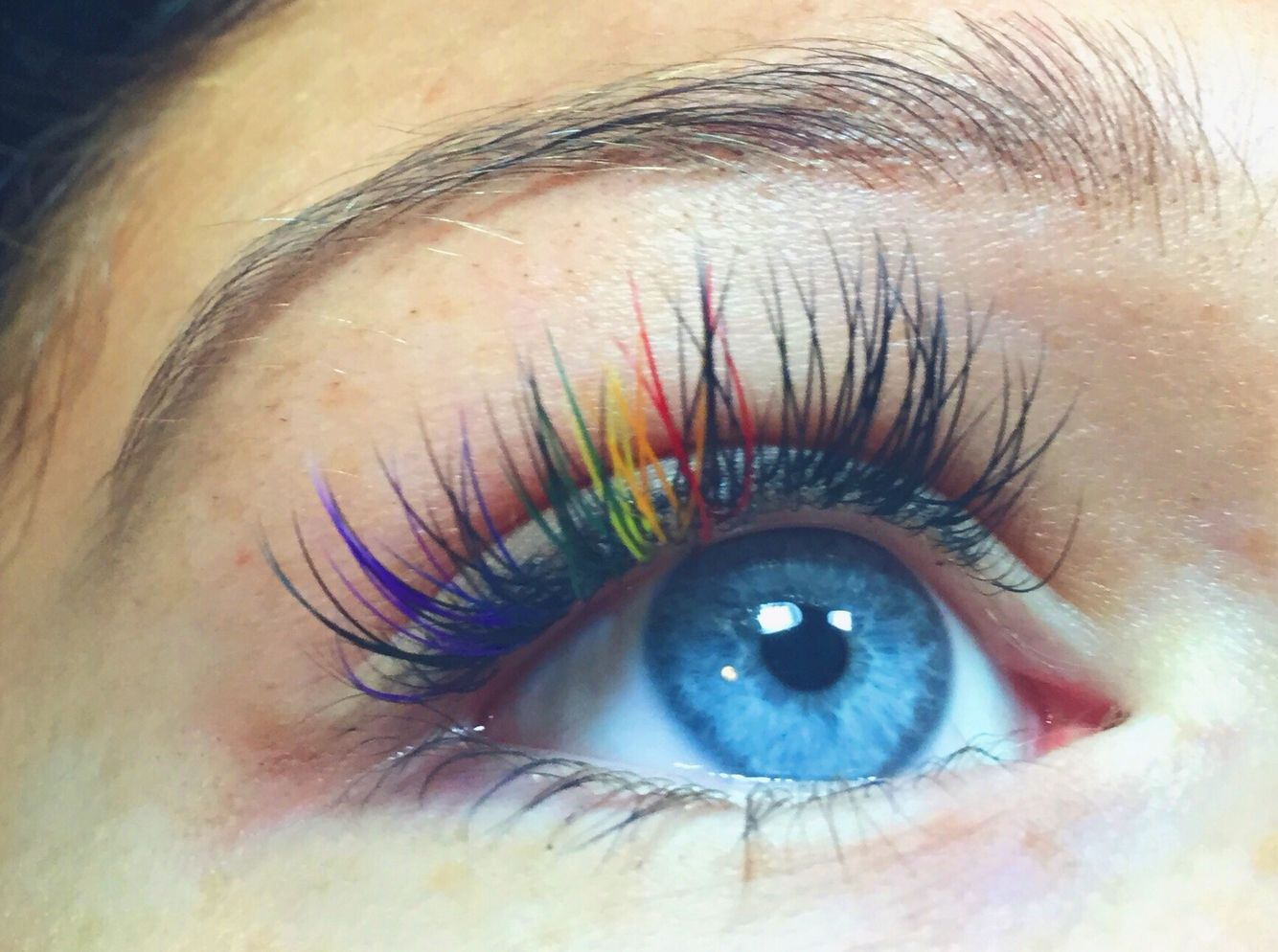 ce0ed6acede Rainbow colored eyelash extensions! Done by me on my gorgeous client with these  beautiful blue eyes for Rhode Island Pride !