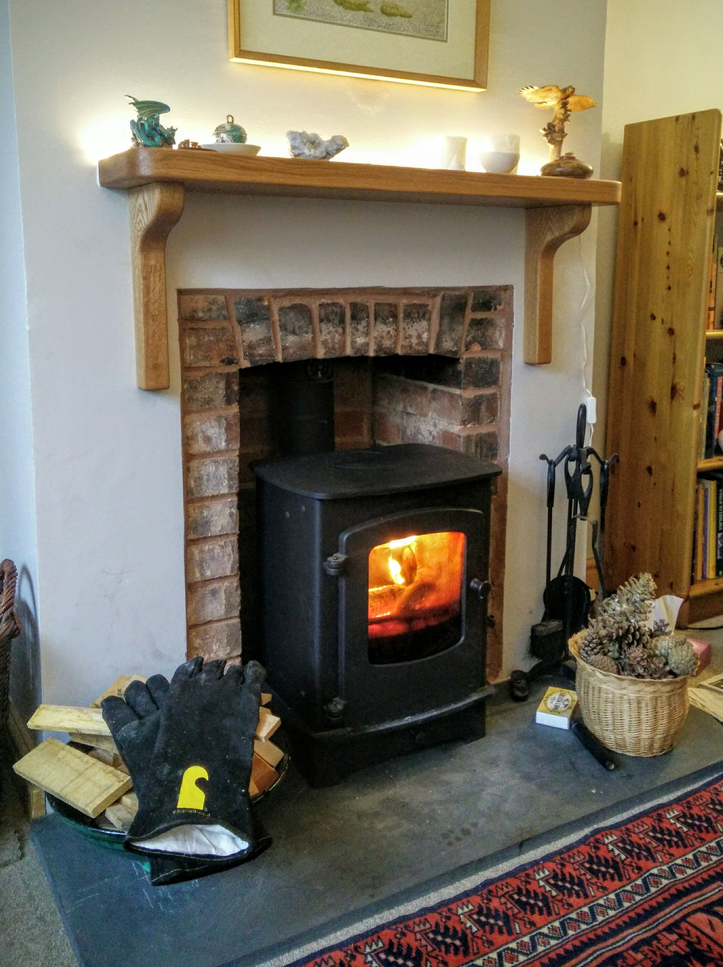 charnwood cove 1 fitted into repointed fireplace with oak shelf
