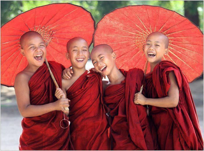 red. kids in monk's robes