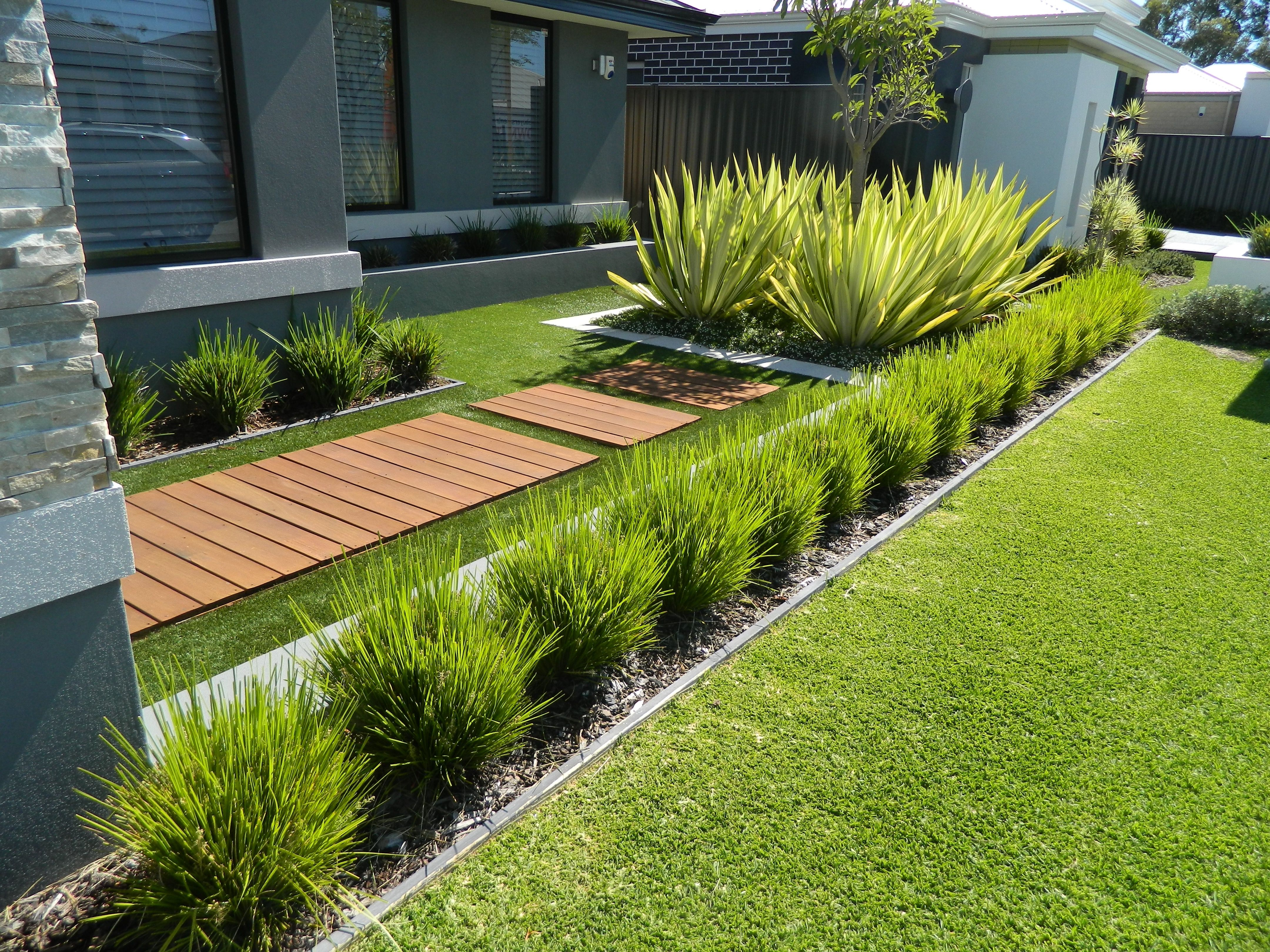 One of our front yard design modern contemporary fake for Ornamental grass bed design