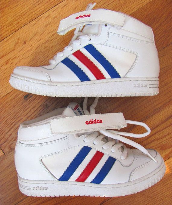 Stretch your legs in professional slam dunk style with these crazy rare Adidas that never actually came out. Theyre a boys version thats a cross between the Mens Top Ten and Forum styles with a completely different, simplified red embroidered logo. The majority of the sneaker is all white leather with blue and red stripes. Ive been collecting sneakers for over 2 decades and I have never seen another pair. These sneakers are in outstanding vintage condition. Theyre barely worn, almost new…