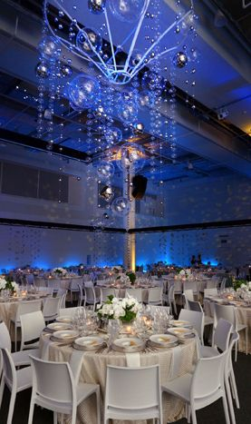 Bubble and disco ball hanging event decor installation shared on bizbash