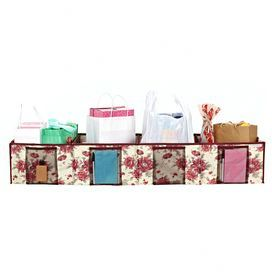 Trunk organizer with four mesh pockets and a floral motif.Product: Trunk organizerConstruction Material: PolyesterColor: CranberryDimensions: 12 H x 47 W x 12 D