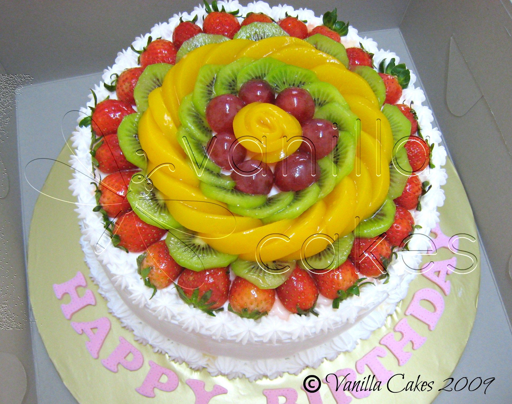 fresh fruit cake vanilla sponge with whipped cream and lots lots lots of chopped fruits. Black Bedroom Furniture Sets. Home Design Ideas