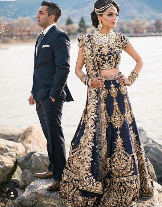 Indian Bride And Groom Wedding Reception Lehenga