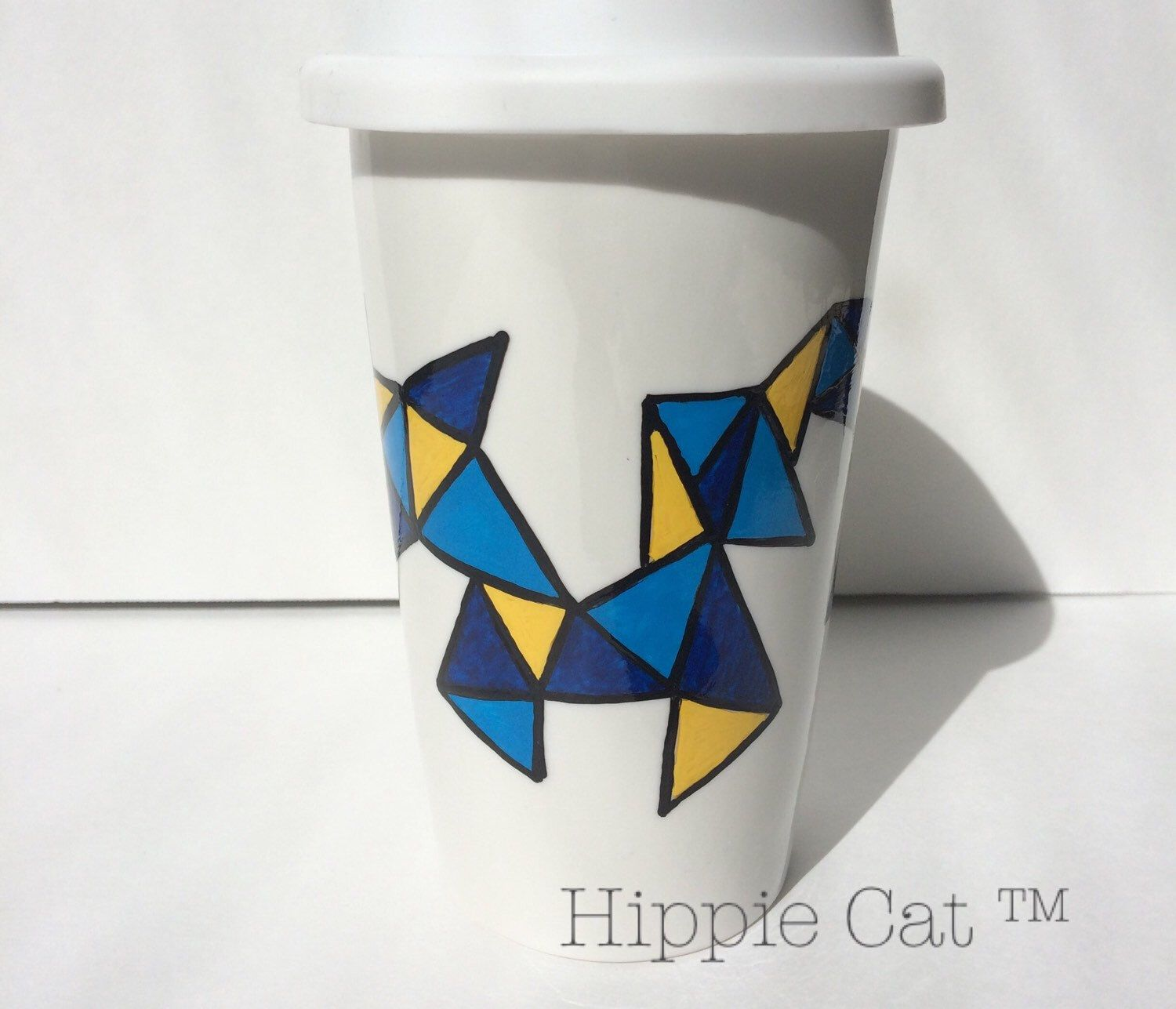 A personal favorite from my Etsy shop https://www.etsy.com/listing/462751673/hippie-cat-geo-travel-mug
