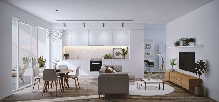 Zona giorno con soggiorno, cucina e sala da pranzo, pareti bianche e ...