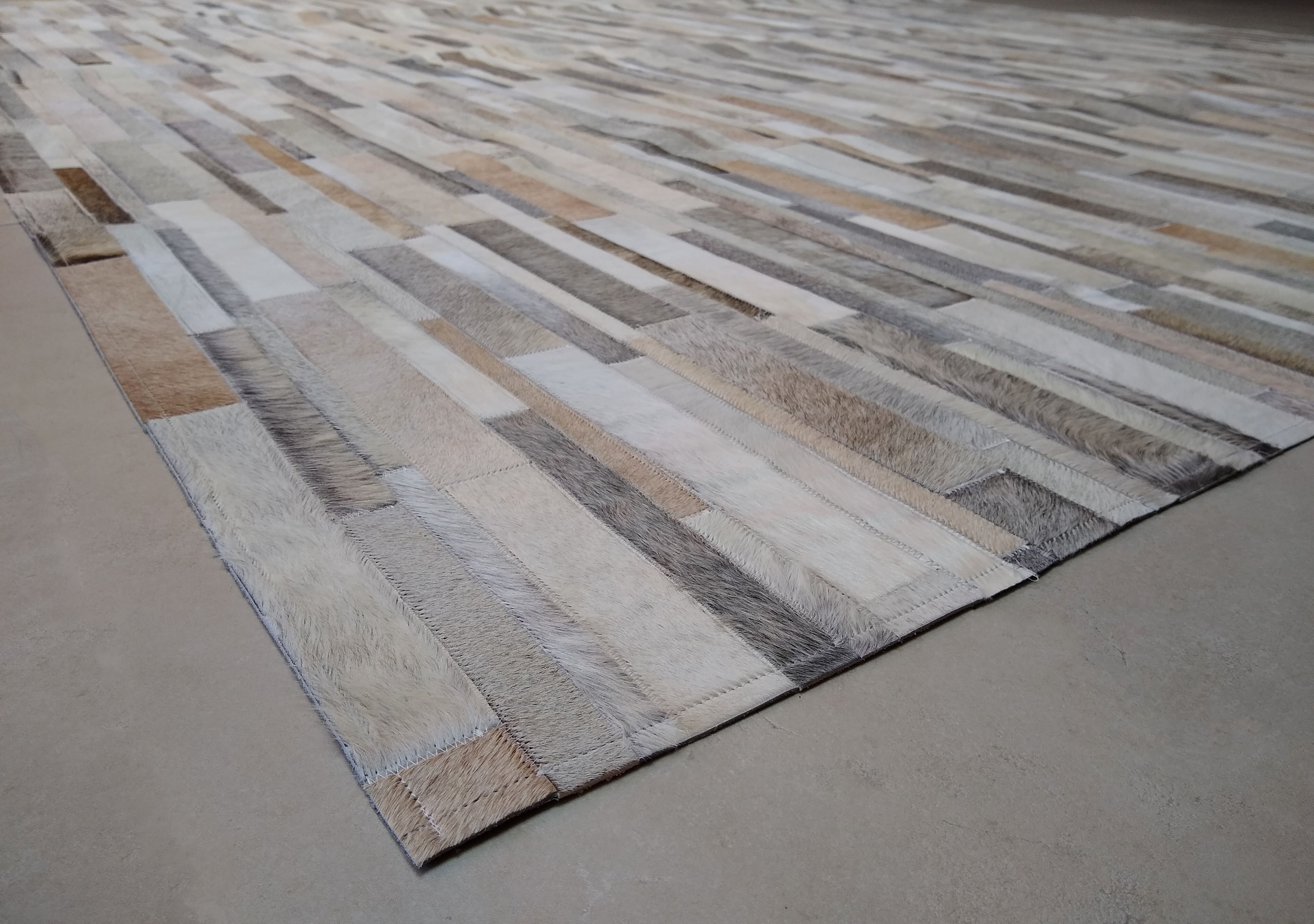 You Won T Get Over Our Unique Gray Beige White Leather Area Rug Stripes Design So You Better Get It Right Now In 2020 Patchwork Cowhide Rug Patchwork Cowhide Rugs