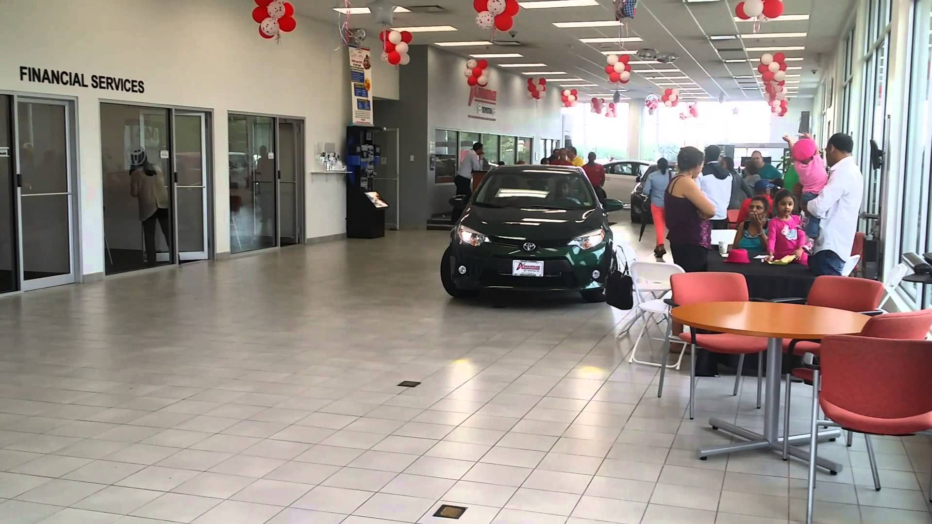 Sales Consultant Aramis Teveras drives a shiny new