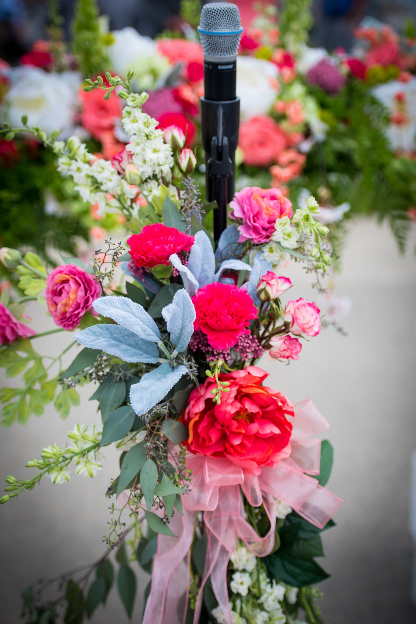 Floweradorned microphone stand at a ceremony weddings