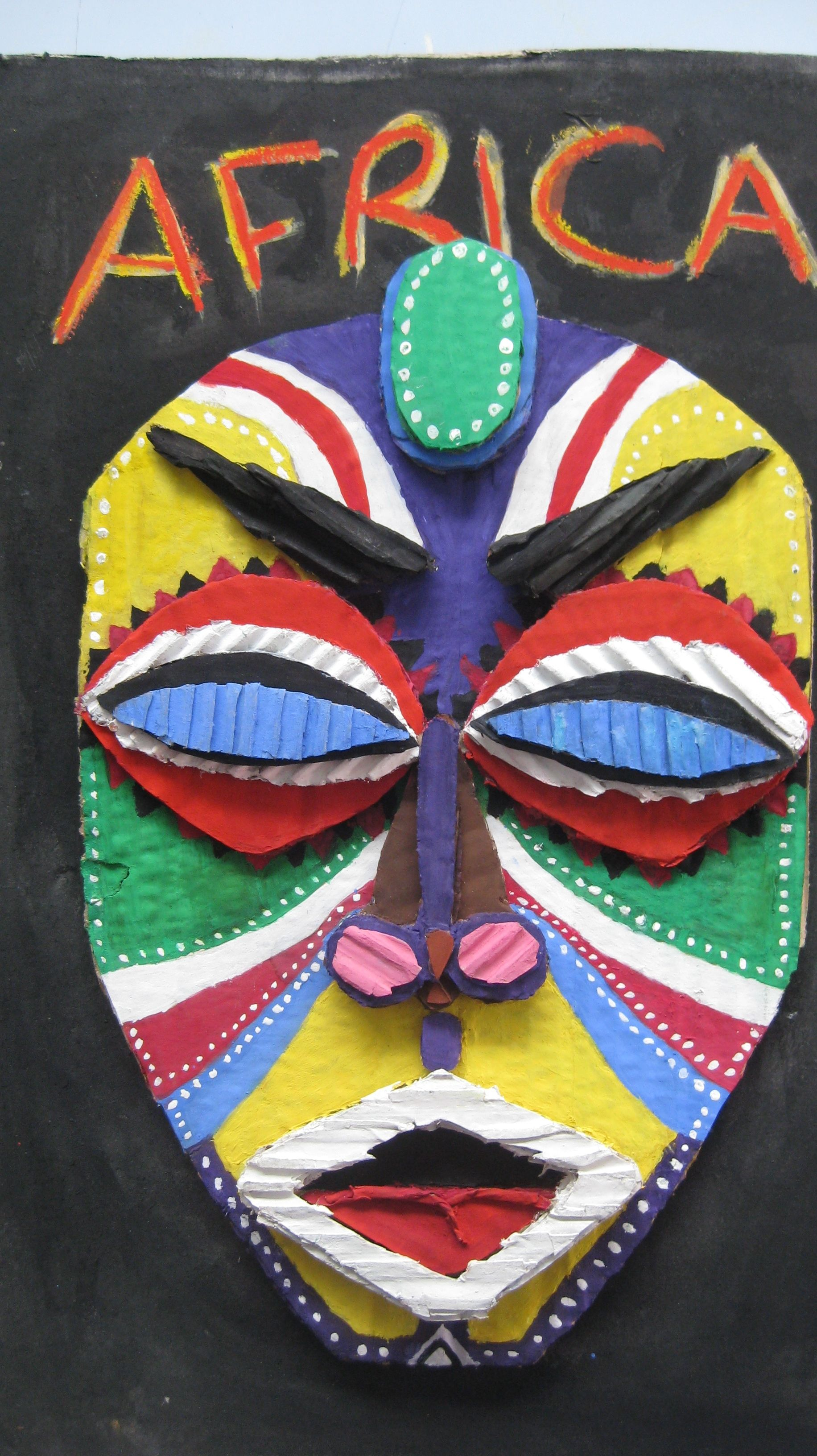 Lovely cardboard mask made from layering of cardboards for for African arts and crafts history